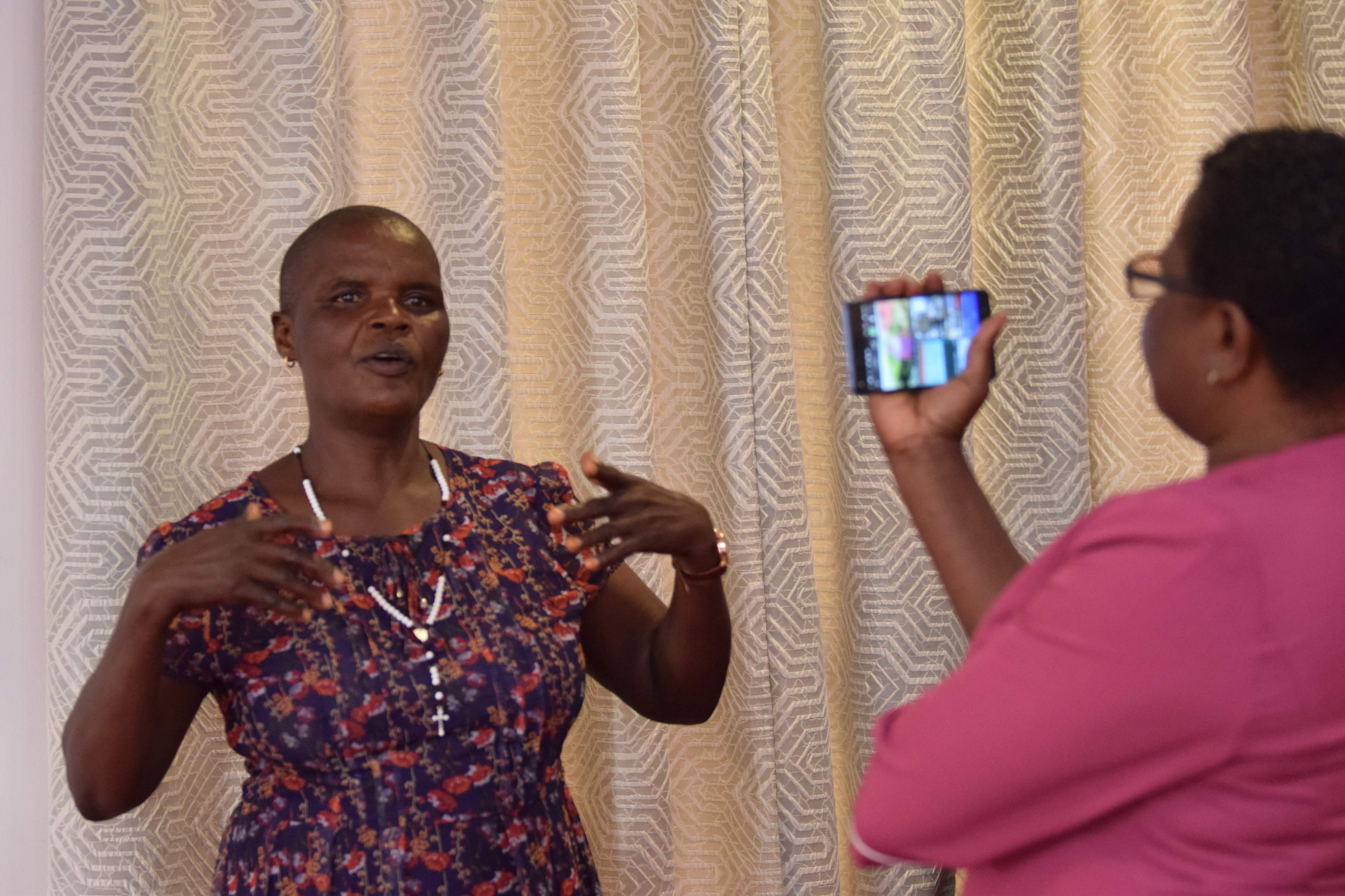 Jessica Kwete and Susy Musungu learning on how to use smart Phoee to record good quality videos and photos for advocacy